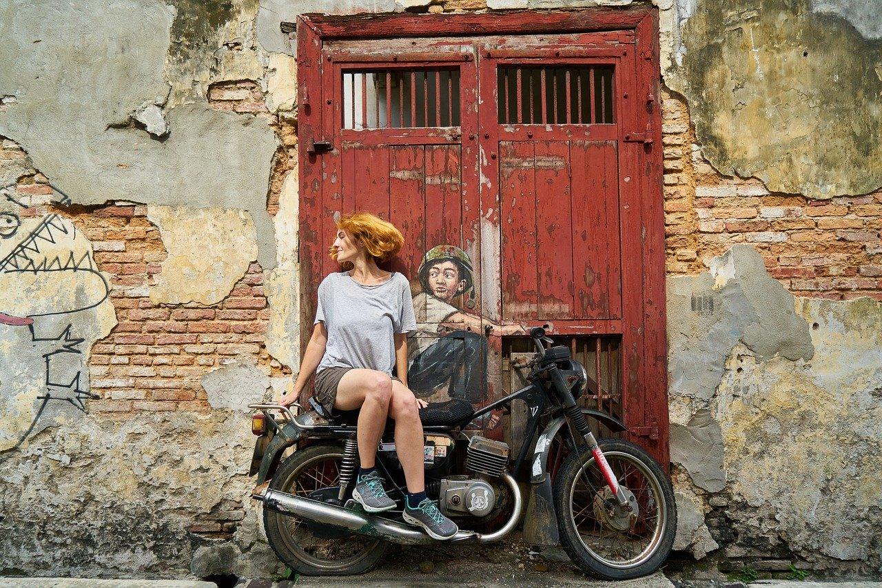 motorcycles, woman, graffiti
